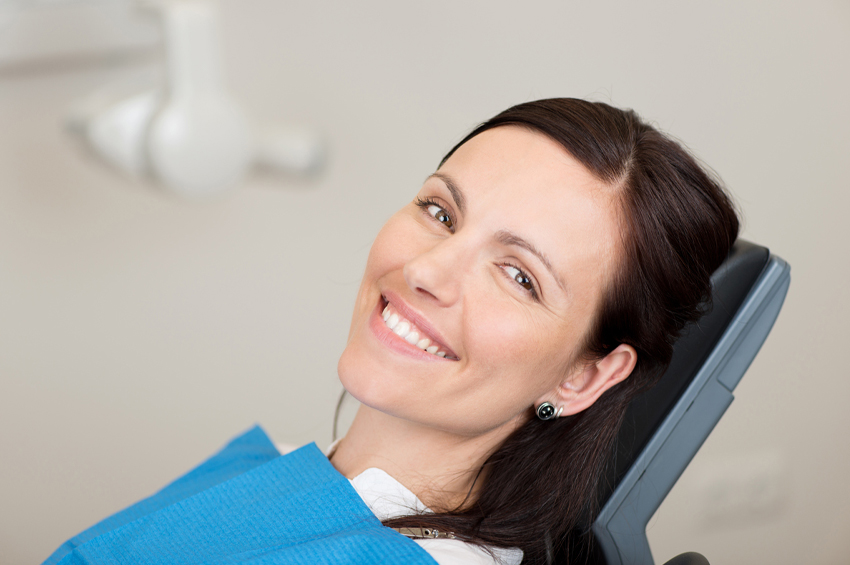 woman getting her teeth cleaning